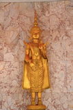 Deva statue. Close up golden statue of deva in the temple at Saraburi province stock image