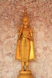 Deva statue. The close up isolate golden statue of deva stock image