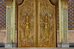 Deva statue on  door . Stock Image