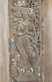 Deva statue wood carving Royalty Free Stock Image