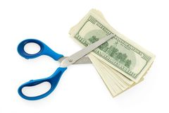 Devaluation. Hundred dollar bils with scissors Stock Photo