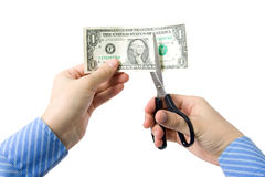 Devaluation of money. Hand with scissors, cutting one dollar bill Royalty Free Stock Photo