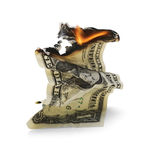 Devalued dollar. Dollar bill in fire. The devaluation of the U.S. dollar has been gaining steam royalty free stock image