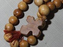 Devanie pärlor med ett kors Royaltyfri Foto