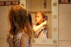 Devant le miroir Photographie stock libre de droits