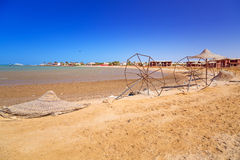 Devastated beach with broken parasols. At Red Sea in Egypt stock photography
