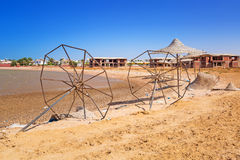 Devastated beach with broken parasols. At Red Sea in Egypt stock photo