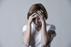 Devastated depressed woman crying sad feeling hurt suffering depression in sadness emotion. Young devastated depressed woman crying sad feeling hurt suffering stock images