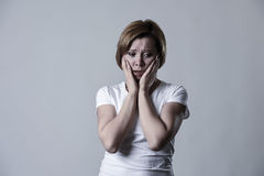 Devastated depressed woman crying sad feeling hurt suffering depression in sadness emotion. Young devastated depressed woman crying sad feeling hurt suffering Royalty Free Stock Photos
