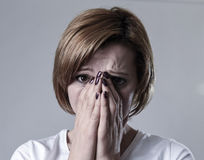 Devastated depressed woman crying sad feeling hurt suffering depression in sadness emotion. Young devastated depressed woman crying sad feeling hurt suffering Royalty Free Stock Image