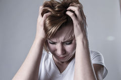 Devastated depressed woman crying sad feeling hurt suffering depression in sadness emotion. Young devastated depressed woman crying sad feeling hurt suffering royalty free stock photo
