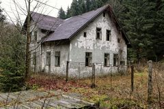 Devastated deserted family house with open windows. By the forest stock photos