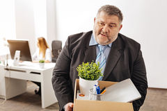 Devastated fired employee being emotional Royalty Free Stock Photos