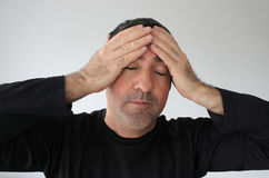 Devastated man. Age 40 with closed eyes has an idea. Real people. Sadness concepts and ideas. Copy space royalty free stock photography