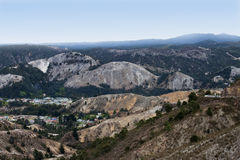 Devastated Mountains. Landscape showing environmental devastation in hills surrounding Queenstowm Tasmania due to copper mining over many years royalty free stock photos