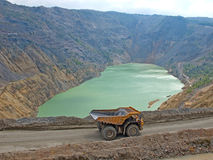 Devastated nature on an open pit copper mine. Of the mine Majdanpek in Serbia and a tipper for ore transportation stock photos