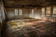 Devastated room in an abandoned building, urbex location. Devastated room in an abandoned building royalty free stock image