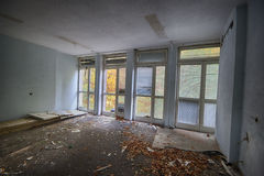 Devastated room in a building designed for renovation. Devastated a dorm room in hoom royalty free stock photos