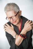 Devastated senior woman. Sad elderly lady expressing deep sorrow royalty free stock images