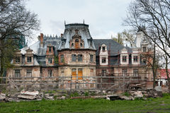 Devastated Sobanski Palace. GUZOW TOWN, POLAND - APRIL 20, 2014: Devastated Sobanski Palace, neo renaissance manor house, garden side royalty free stock photos