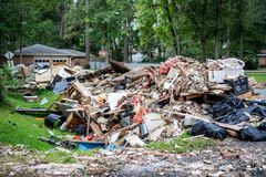 The devastation of Hurricane Harvey. Trash and debris outside of Houston homes devastated after Hurricane Harvey royalty free stock image