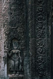 Devata sculpture without head in Ta Prohm temple at Angkor complex, Siem Reap, Cambodia Stock Image