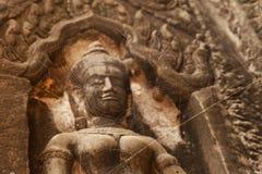Devata statue in Ta Phrom Stock Photo