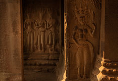 Devata statues in Angkor Wat Stock Images