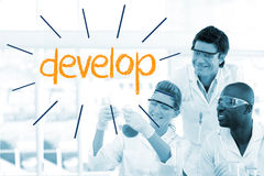 Develop against scientists working in laboratory Stock Photography