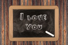 Develop I love you - chalkboard. I love you - chalkboard with 3D outlined text - on wood Stock Image