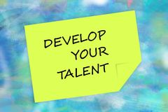 Develop your talent message  on yellow note Royalty Free Stock Image