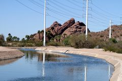 USA, Arizona: Irrigation canal and power lines Royalty Free Stock Image