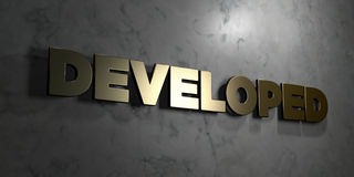 Developed - Gold sign mounted on glossy marble wall  - 3D rendered royalty free stock illustration Royalty Free Stock Photography