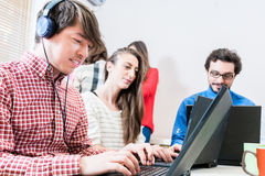 Developer in IT startup company programming on pc Stock Photos