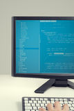 Developer working on source codes on computer at office Royalty Free Stock Image