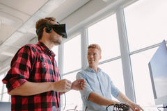 Developers testing an virtual reality device Royalty Free Stock Photos