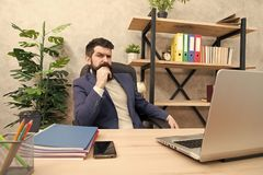 Developing business strategy. Risky business. Concentration and focus. Man bearded boss sit office with laptop. Manager. Solving business problems. Businessman royalty free stock images