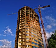 Developing high-rise residential building. Developing high-rise concrete residential building with crane Royalty Free Stock Photography