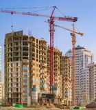 Developing high-rise residential building. Developing high-rise concrete residential building with crane royalty free stock images