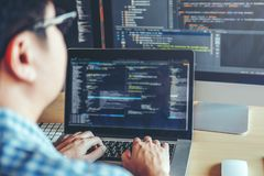 Developing programmer Development Website design and coding tech. Nologies working in software company office stock photos