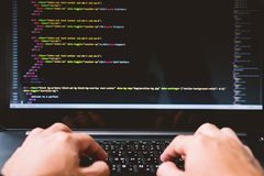 Developing programming and coding technologies on desk white blu royalty free stock photography