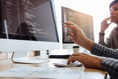 Developing programming and coding technologies working in a software engineers developing applications together in office.  royalty free stock images