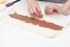 Developing sweet puff pastry. Doing at home with natural ingredients of sweet pastry filled with chocolate Stock Image