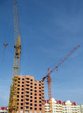 Development. Two building cranes are on a construction yard Royalty Free Stock Photography