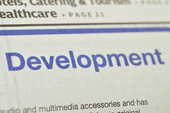 Development on business newspaper Stock Photo