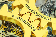 Development Economics concept on the gearwheels, 3D rendering Stock Images