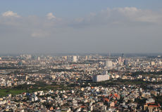 Development of modern city. HO CHI MINH CITY (SAI GON), VIET NAM - SEP 15, 2014. Development of modern city with row of highrise buidling rise up to sky and new Stock Photography