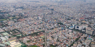 Development of modern city. HO CHI MINH CITY (SAI GON), VIET NAM - SEP 15, 2014. Development of modern city with row of highrise buidling rise up to sky and new Stock Photos