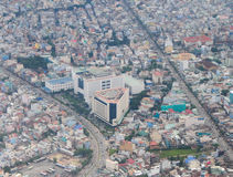 Development of modern city. HO CHI MINH CITY (SAI GON), VIET NAM - SEP 15, 2014. Development of modern city with row of highrise buidling rise up to sky and new Stock Image