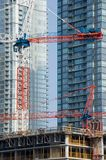 Development, New Constraction. New construction against brand new buildings. Concept for development Royalty Free Stock Images